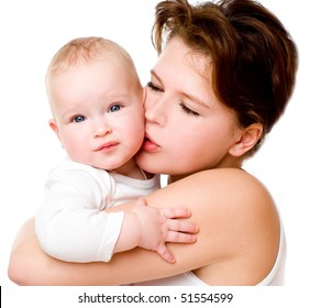 A mother kissing her cute baby
