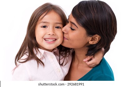 mother kissing her daughter's cheek, concept of family love