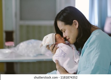 Mother kissing her newborn baby, The love of a mother concept