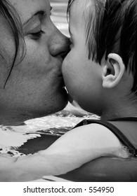 Mother kissing infant