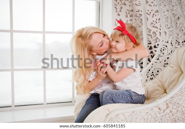 Surprising Mother Kissing Little Daughter Sitting Chair Stock Photo Ncnpc Chair Design For Home Ncnpcorg