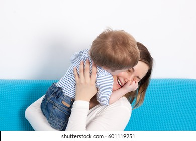 Mother and kissing son having fun time together. Family lifestyle
