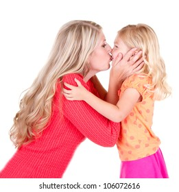 Mother kissing young daughter, isolated on white