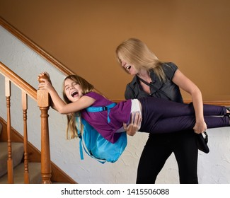 A mother is late for school and work at home rushing her child to hurry up for a funny stress concept.