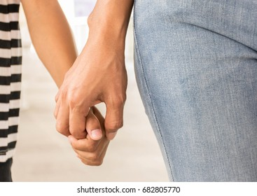 mother lead son hand with love