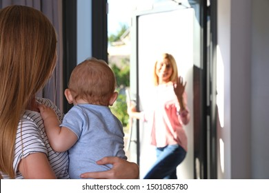 Mother leaving her baby with teen nanny at home. Space for text
