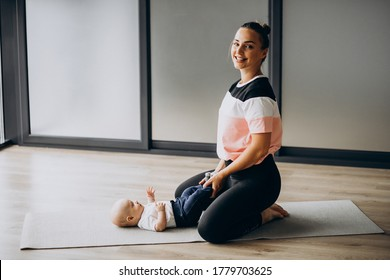 Mother with little baby boy practice yoga