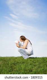 Mother and little baby. Sky. Grass. 2