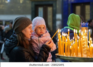Mother with little blond Caucasian daughter in Orthodox Russian Church