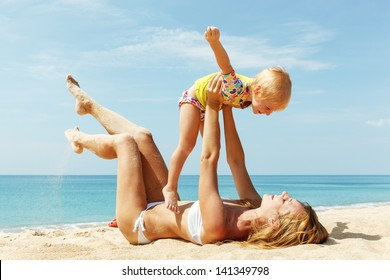 Mother with little daughter on the beach