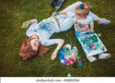 Mother and little daughter paint