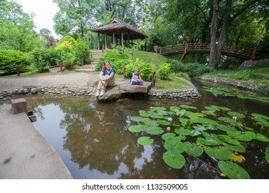 Mother and Little girl relaxing in nature, family spring day outdoor