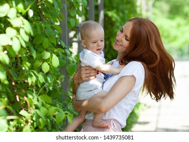 mother with little son in park