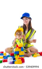 Mother with little son playing with construction blocks. Isolated on white