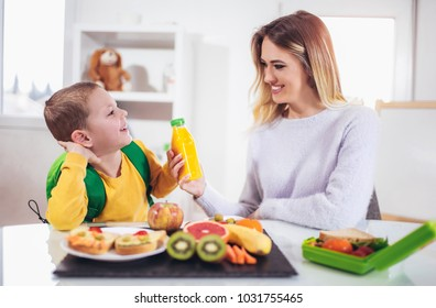 Mother making breakfast for her children in the morning and a snack for school