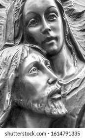 Mother Mary holding her son Jesus. Black and white portrait.