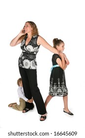 mother on the phone while her children pull and tug at her to get her attention