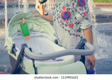 mother over a stroller