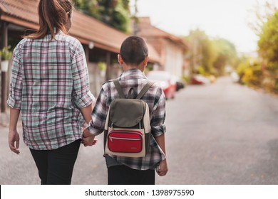 Mother or parent holding hand son or pupil with backpack go to school, Back to school concept, Selective focus.
