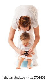 Mother performs potty training with her son using smartphone