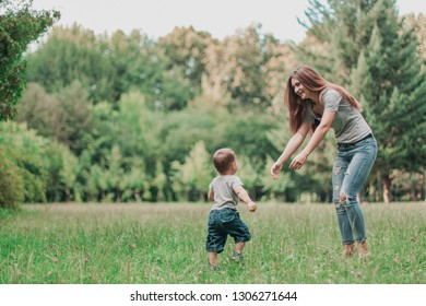 Mother play with son in the park.