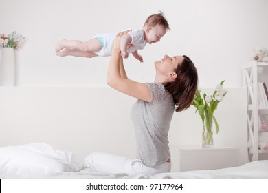 mother playing with baby