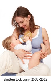 Mother playing with breastfeeding