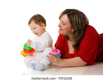 Mother playing with child holding pyramid isolated on white