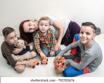 mother is playing with children, concept of happy family