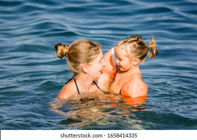 Mother playing with daughter in sea - Cirali, Antalya Province, Turkey