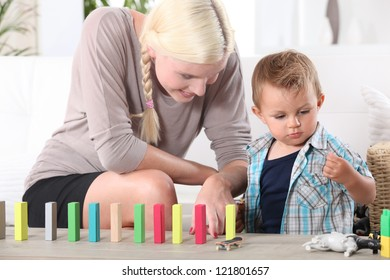 a mother playing with her 3-4 years old son