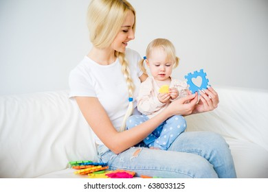 Mother playing with her baby daughter
