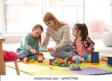 Mother playing with her children at home