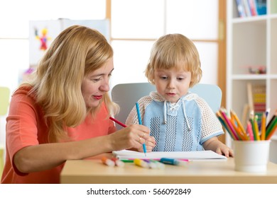 Mother playing with her little son, drawing together