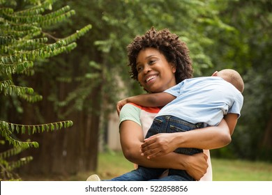 Mother playing with her son outside.