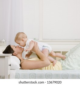 Mother playing with small baby