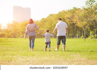 Mother playing with son  in the field. Happy family life style concept.