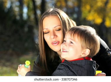 mother playing with son park outdoor