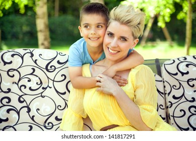 Mother posing with her son