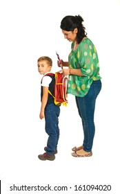 Mother prepare boy for school and giving notebooks isolated on white background