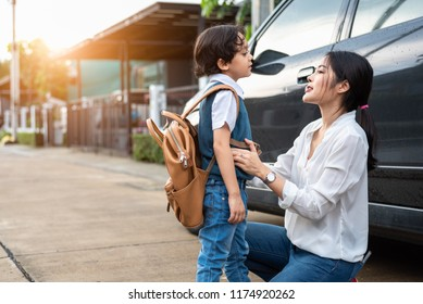 Mother preparing to send her children back to school at car in morning. Mom say Good bye before school start. Education and Back to school concept. Happy family and preschool student and education