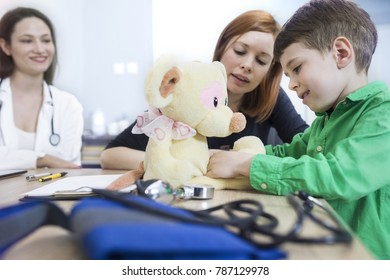 Mother and preschool age boy visiting a doctor