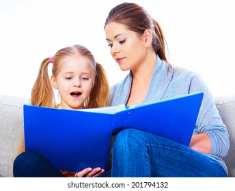 Mother reading book with daughter at home. Isolated.
