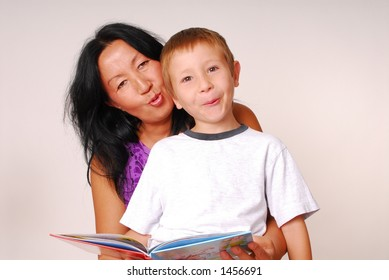 Mother reading to her son