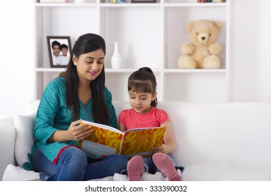 Mother reading a storybook to daughter