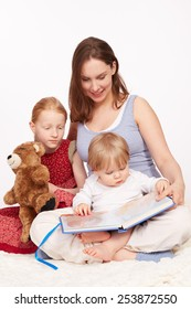 Mother Reads to Kids