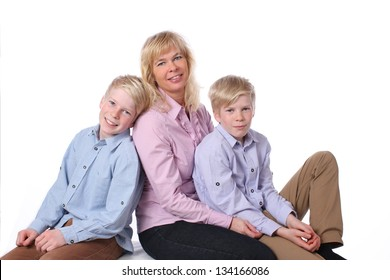 Mother relaxes with her two children