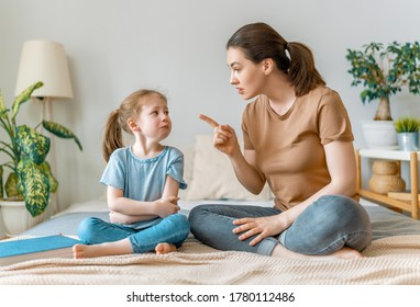 mother is scolding her child girl. family relationships