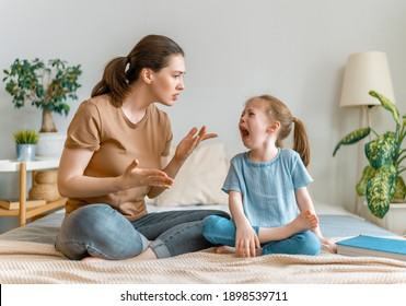 Mother is scolding her child girl, family relationships.