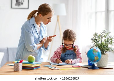 mother scolds a child for poor schooling  and homework at home